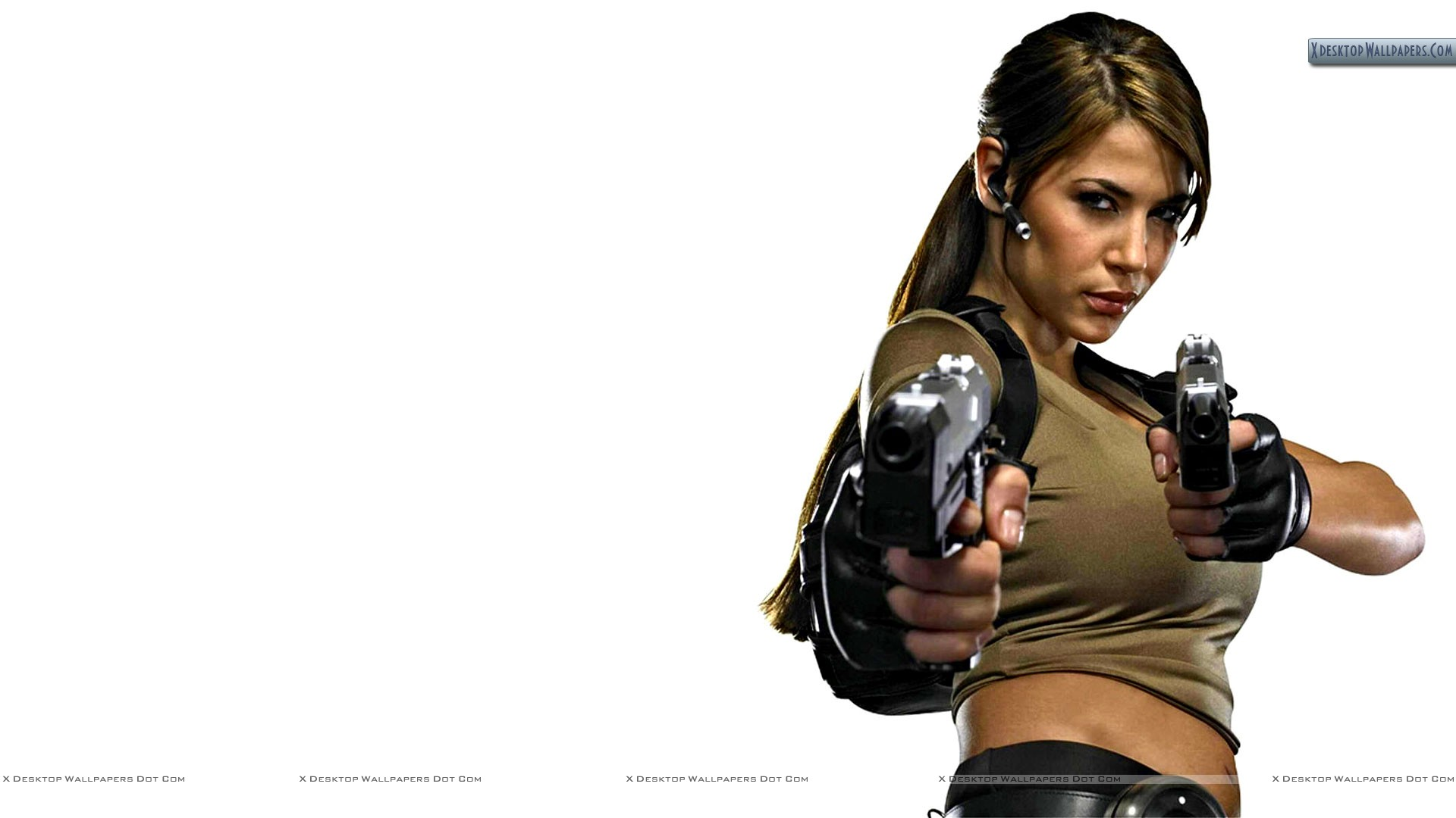 Karima Adebibe in Green Top Holding Guns in Hand Wallpaper: xdesktopwallpapers.com/big-boobs-karima-adebibe-holding-guns-in...
