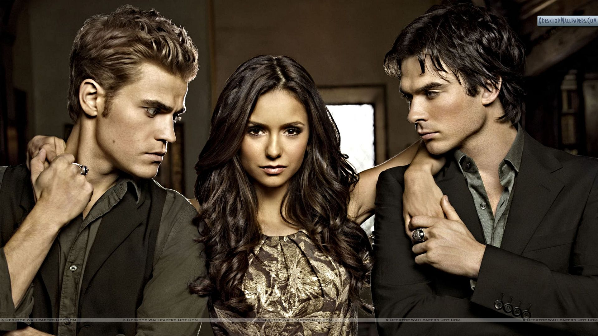 Vampire Diaries – Elena Posing with Stefan And Damon Wallpaper