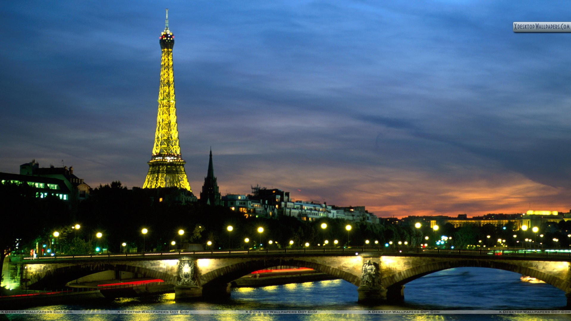 eiffel tower and the seine river at night paris france wallpaper. Black Bedroom Furniture Sets. Home Design Ideas