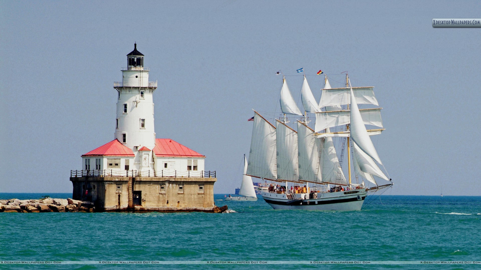 tall ship windy sails past the chicago harbour lighthouse wallpaper