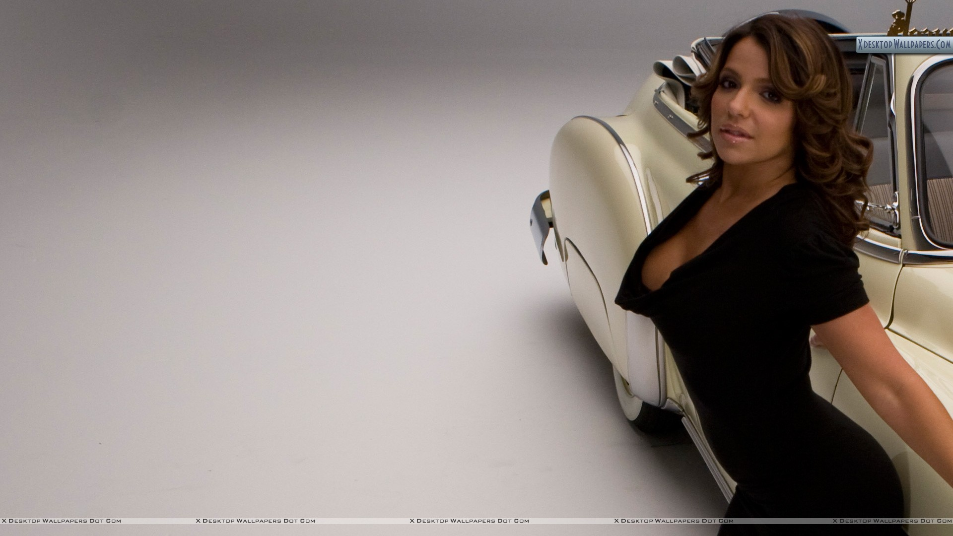 Vida guerra in black dress side pose with car wallpaper you are viewing wallpaper titled vida guerra voltagebd Image collections