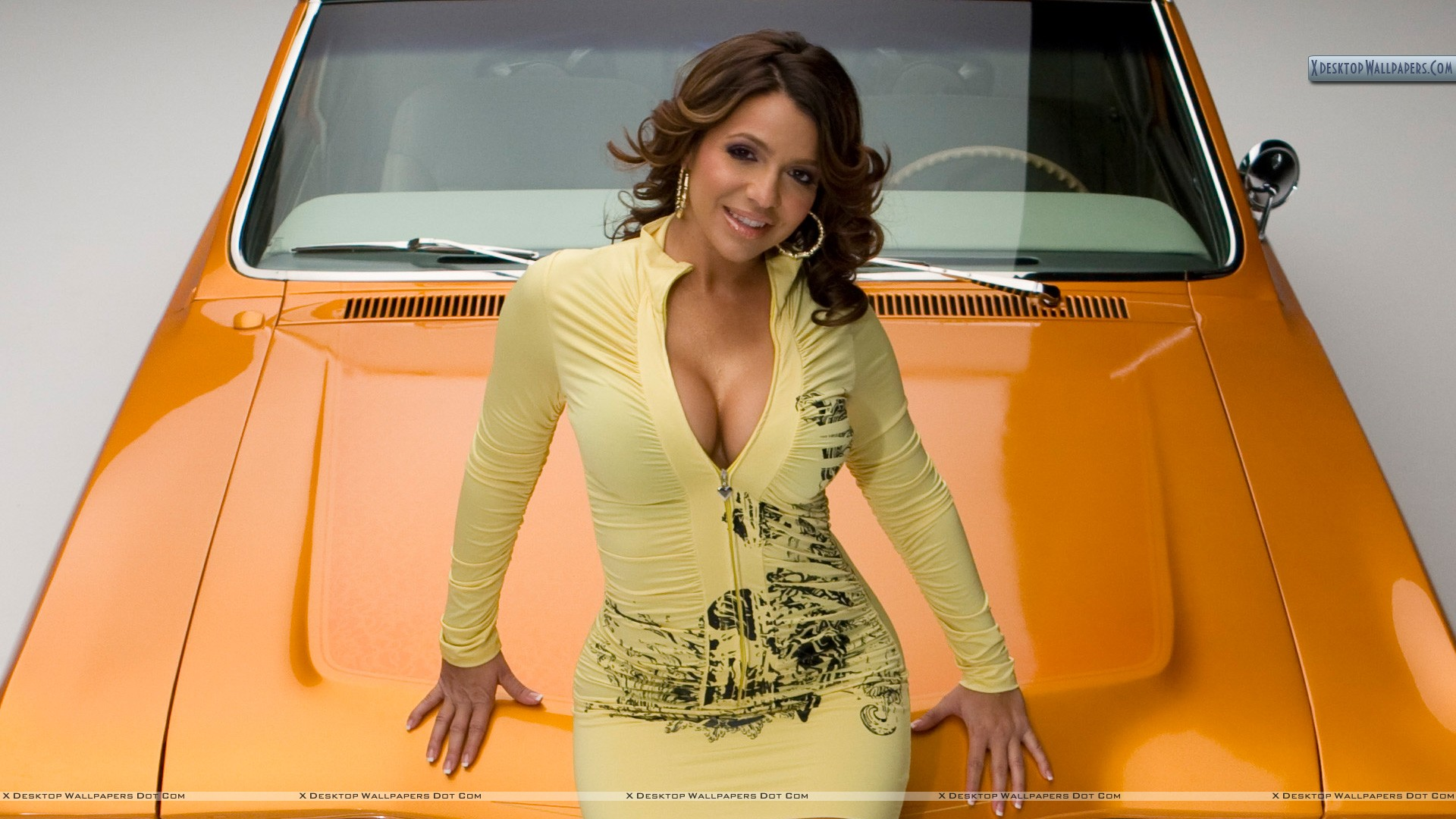 Vida guerra smiling sitting pose on yellow car wallpaper you are viewing wallpaper titled vida guerra voltagebd Image collections