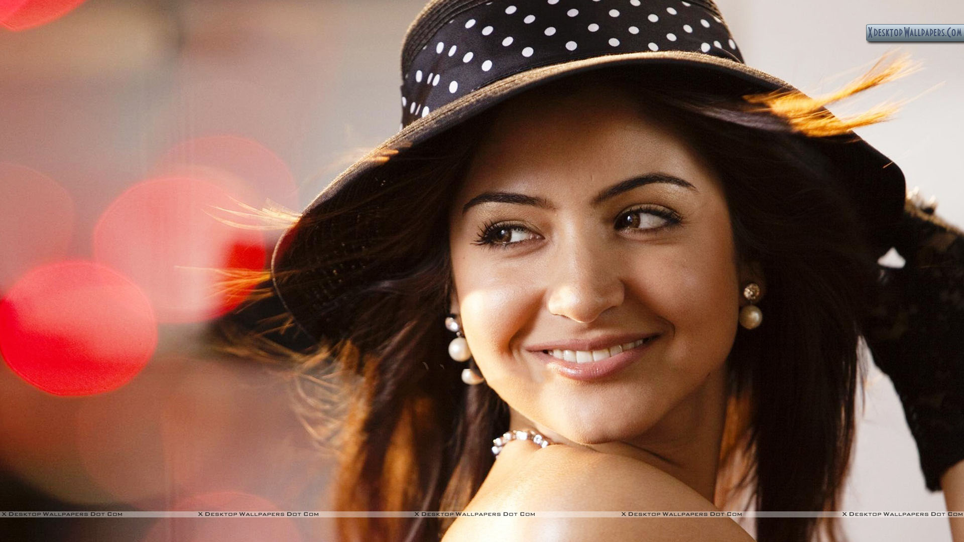 anushka sharma smiling in black doted hat face closeup wallpaper