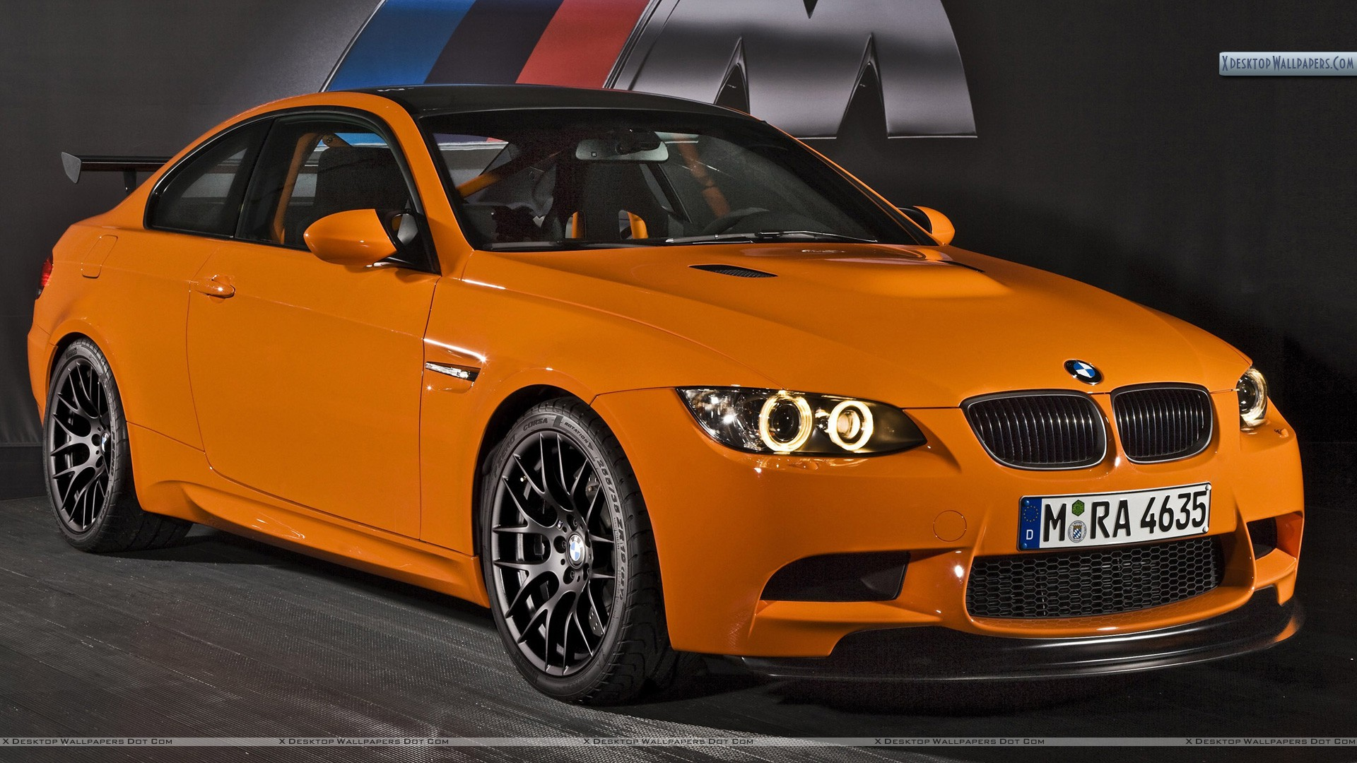 2010 Bmw M3 Gts Front Pose In Orange Color Wallpaper