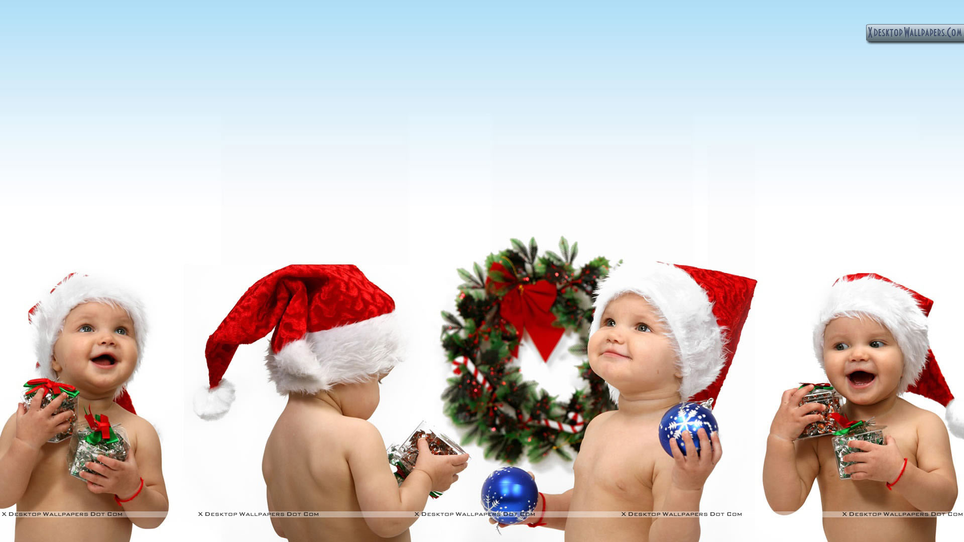 Lovely Happy Babies At Christmas Day Wallpaper