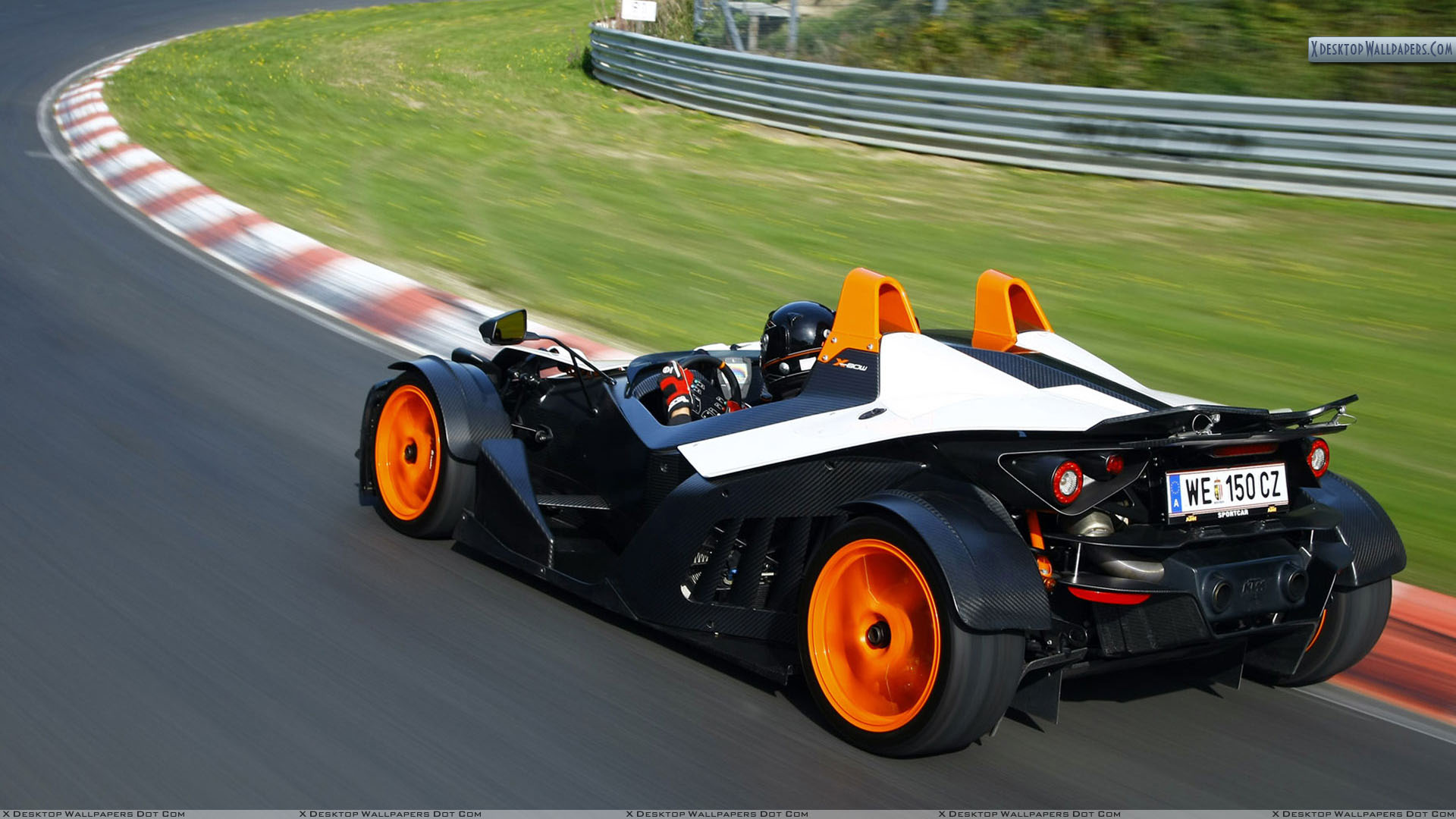 Ktm X Bow Side Back Pose On Racing Tracks Wallpaper