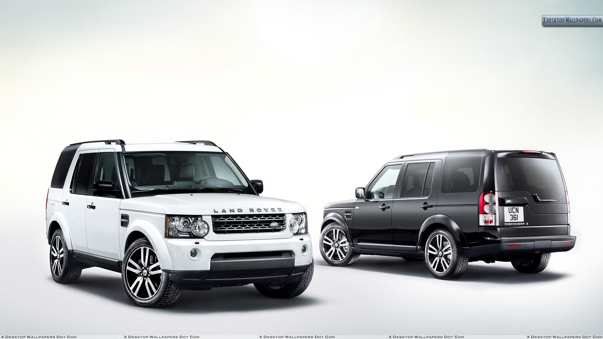 white and black land rover discovery in side front and. Black Bedroom Furniture Sets. Home Design Ideas