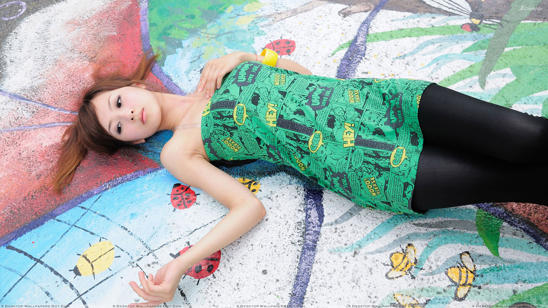 Asian Girl Laying On Sketchy Colorful Ground Wallpaper