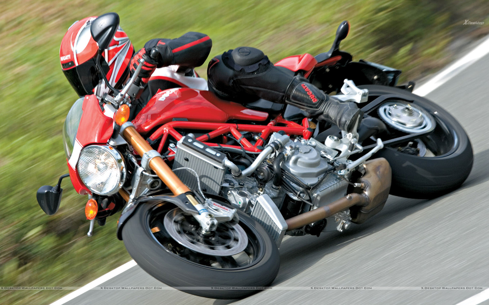 ducati monster s4rs 10 in red riding on road side pose. Black Bedroom Furniture Sets. Home Design Ideas