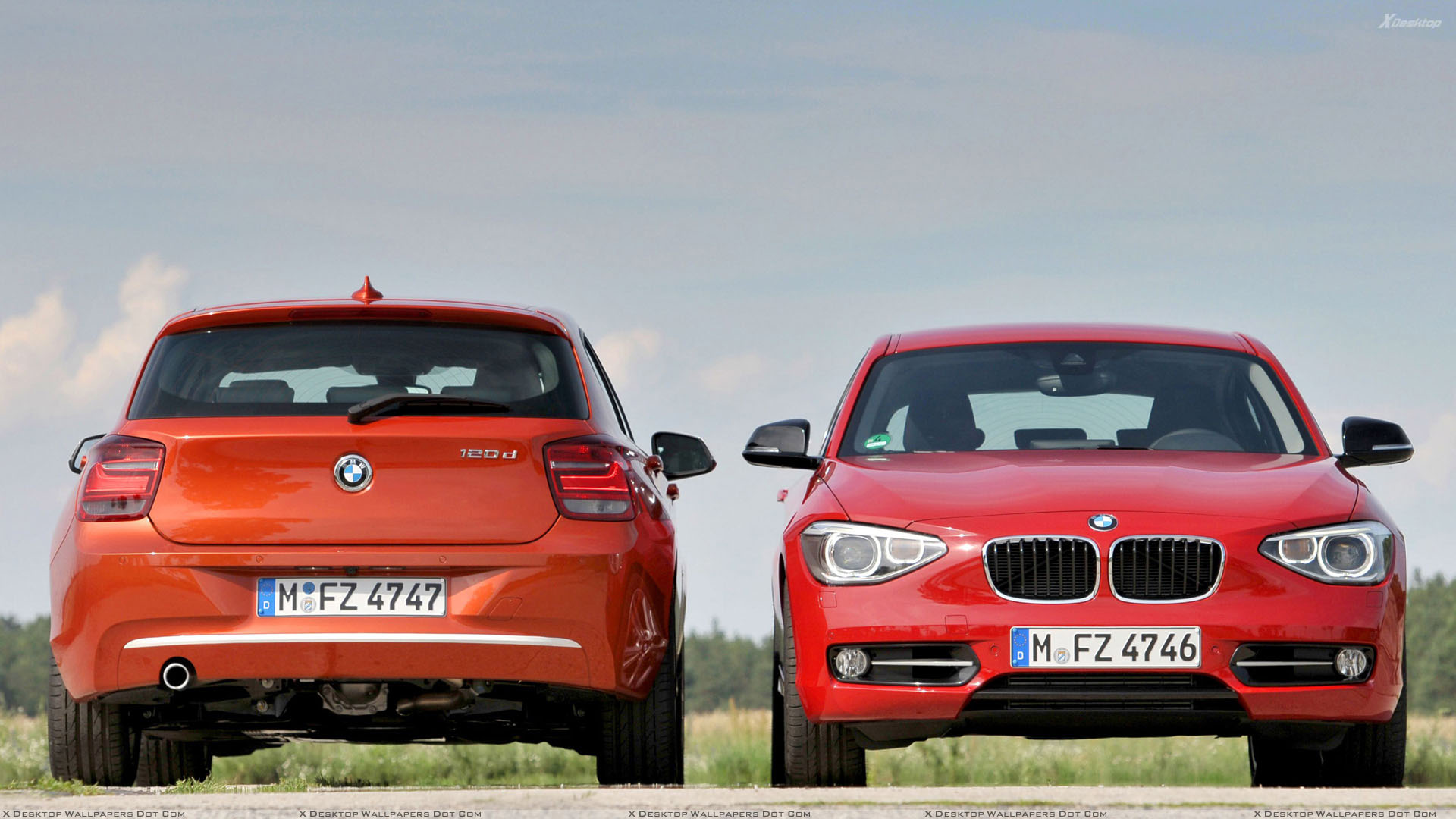 front and back pose of 2012 bmw 1 series in orange and red wallpaper