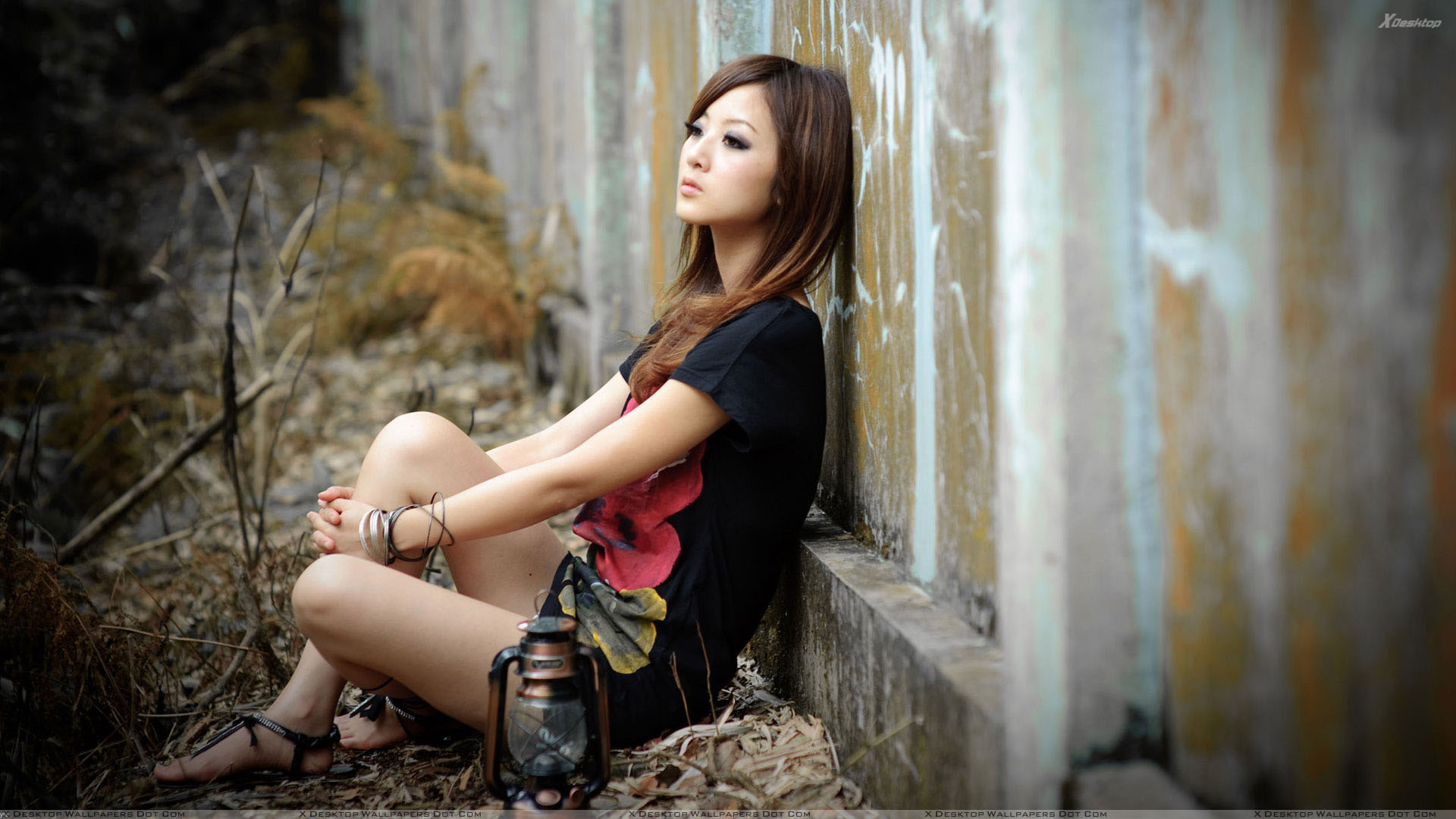 Girl Lost In Love Sitting Pose in Black Top Wallpaper