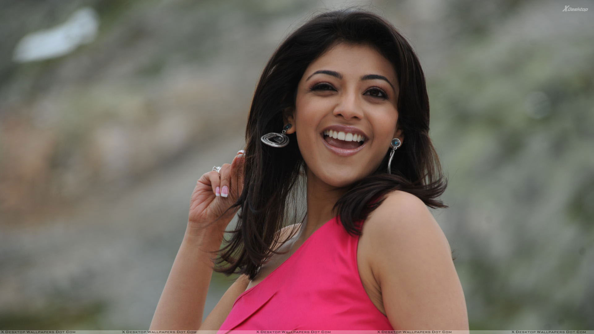 kajal aggarwal laughing naughty pose in pink dress wallpaper