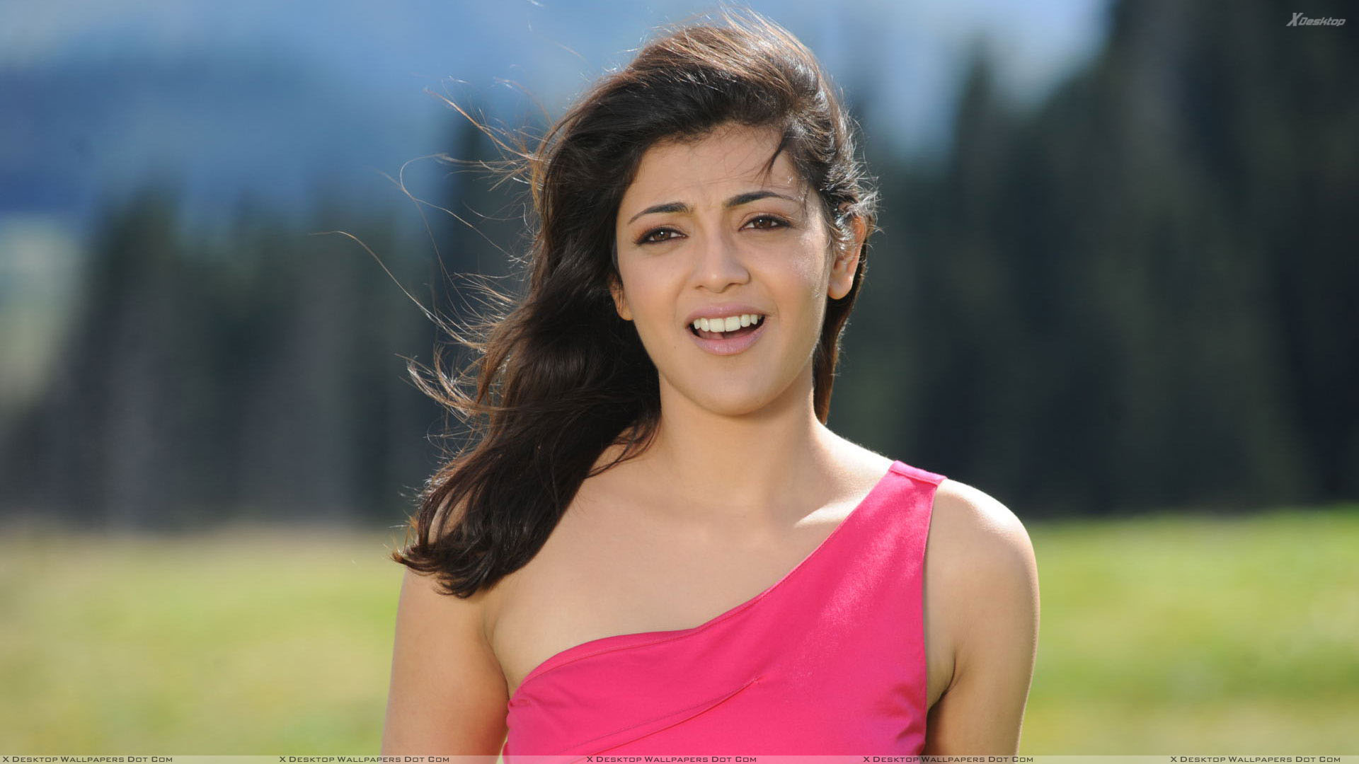 kajal aggarwal open mouth and cute eyes in pink dress wallpaper