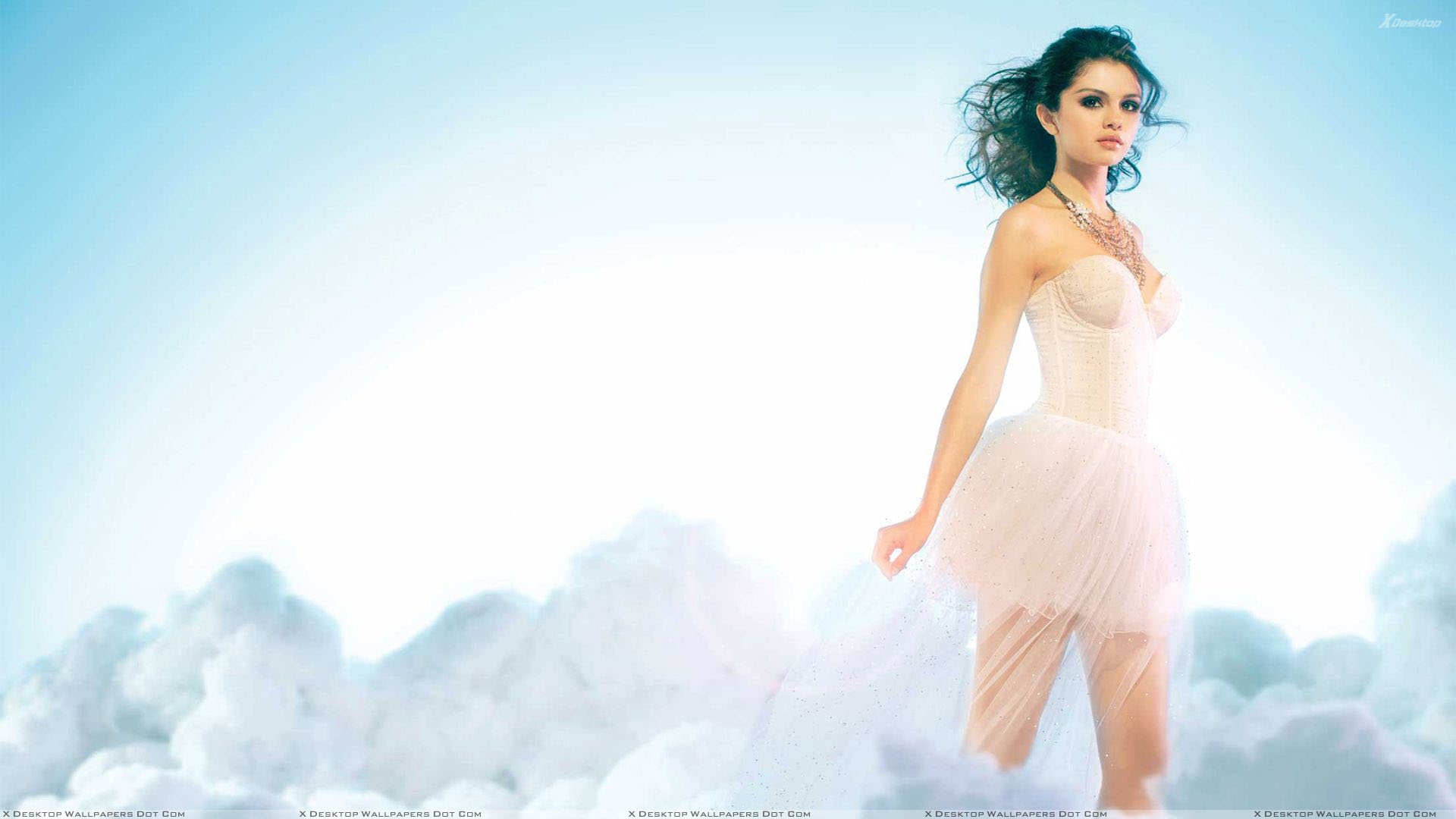 Selena Gomez In White Dress Looking Sweet Photoshoot Wallpaper