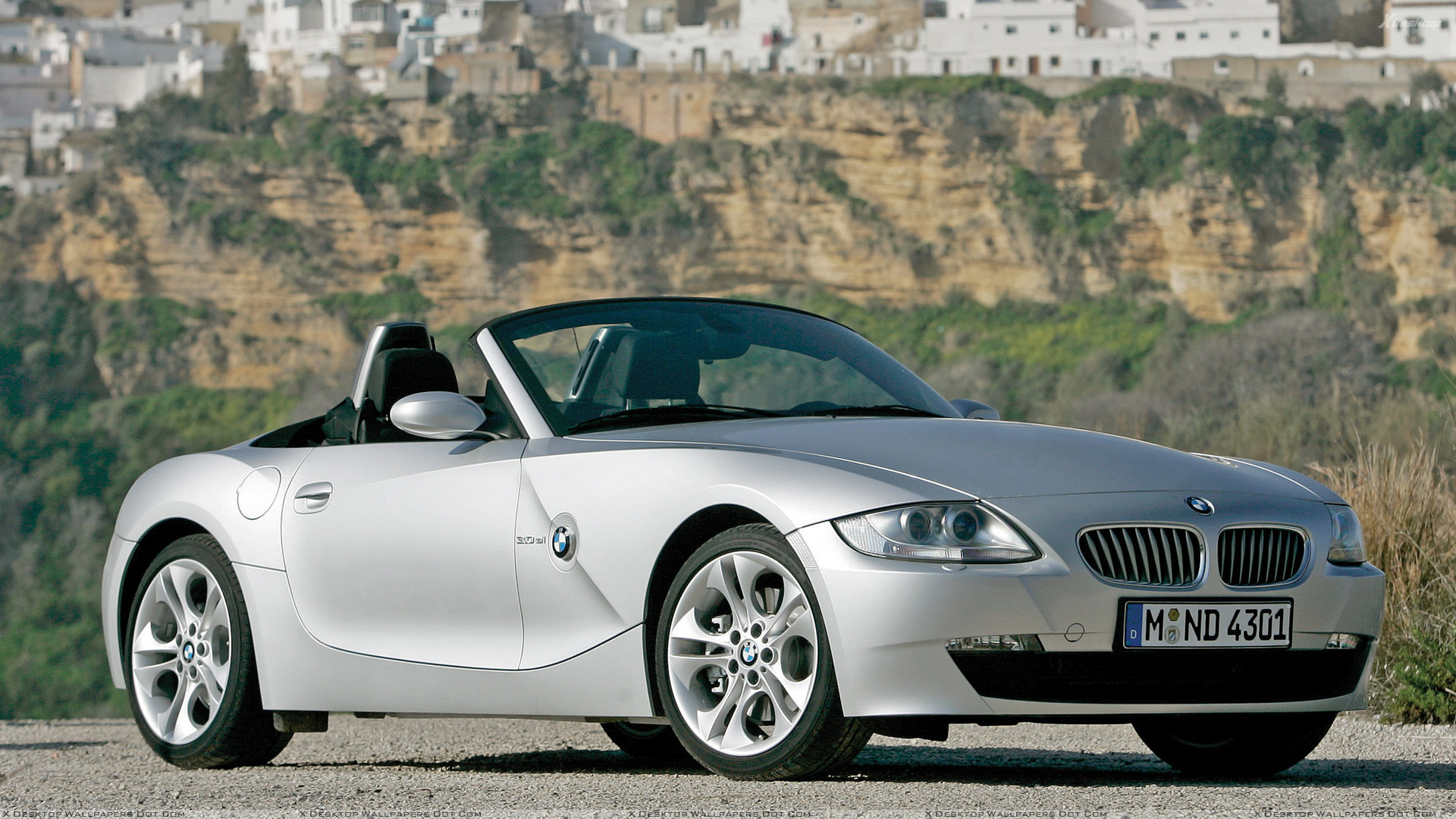 2005 Bmw Z4 Roadster Front Side Pose In Silver Wallpaper