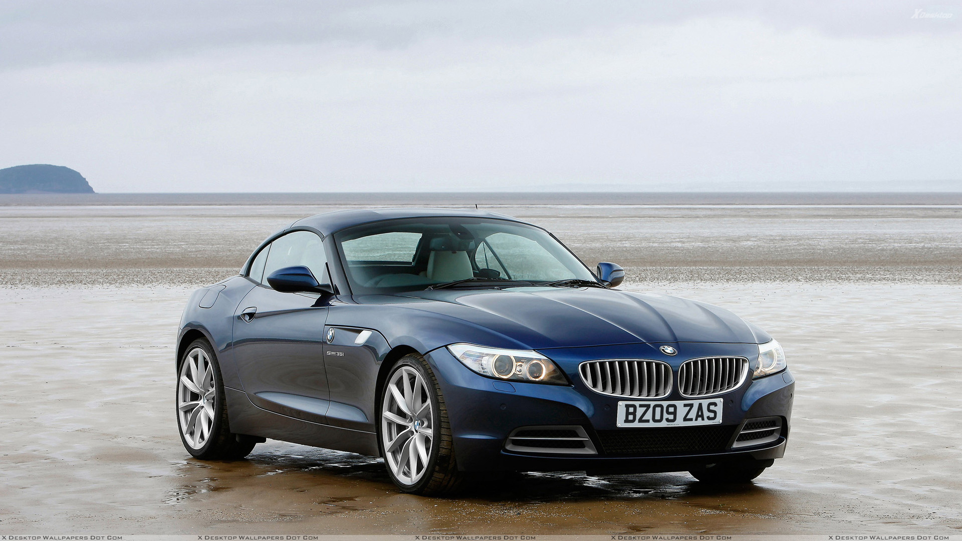 2009 Bmw Z4 Front Side Pose In Blue Wallpaper