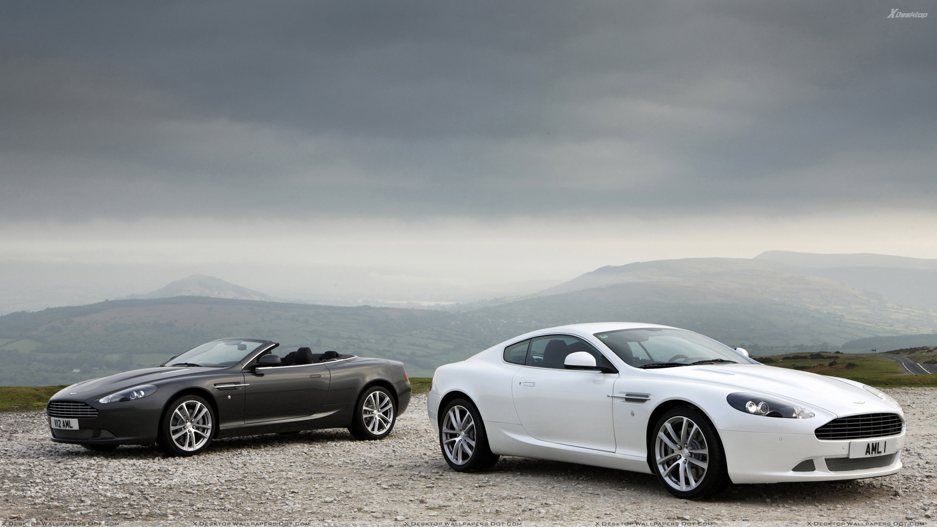 2010 Aston Martin Db9 Black Vs White Near Mountains Wallpaper