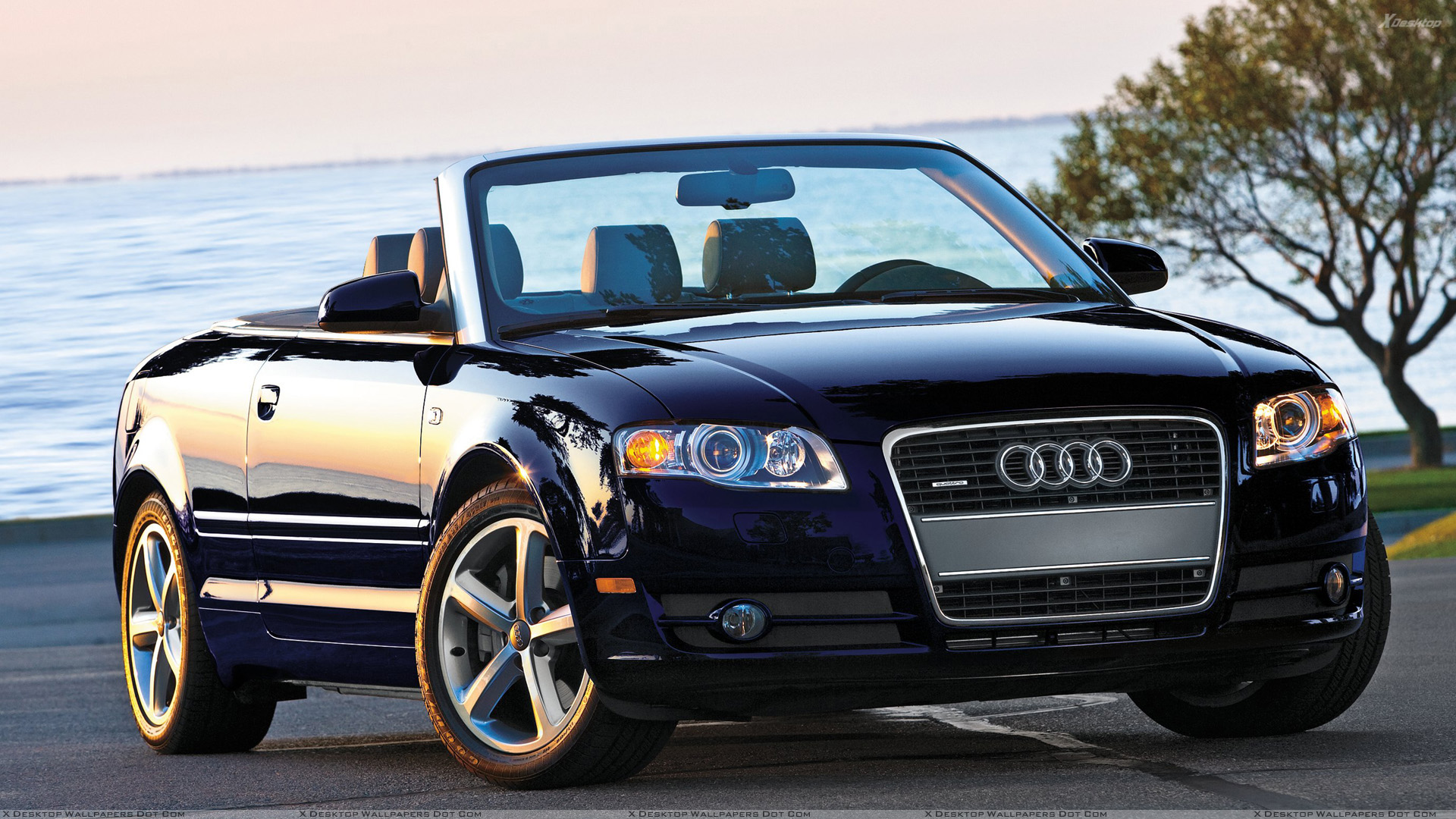 audi a4 cabriolet in shine black front pose near sea side. Black Bedroom Furniture Sets. Home Design Ideas