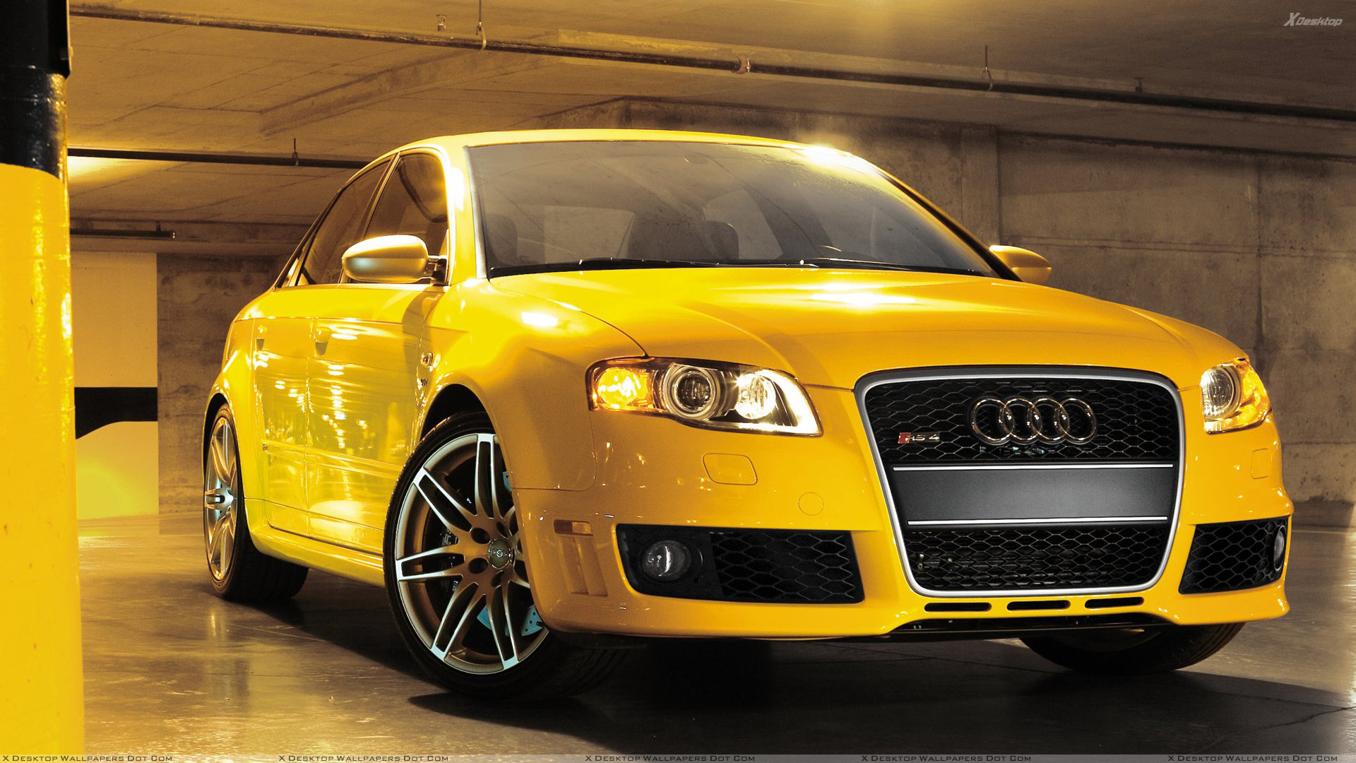 Audi Rs4 Cabriolet Front Pose In Yellow In Garage Wallpaper