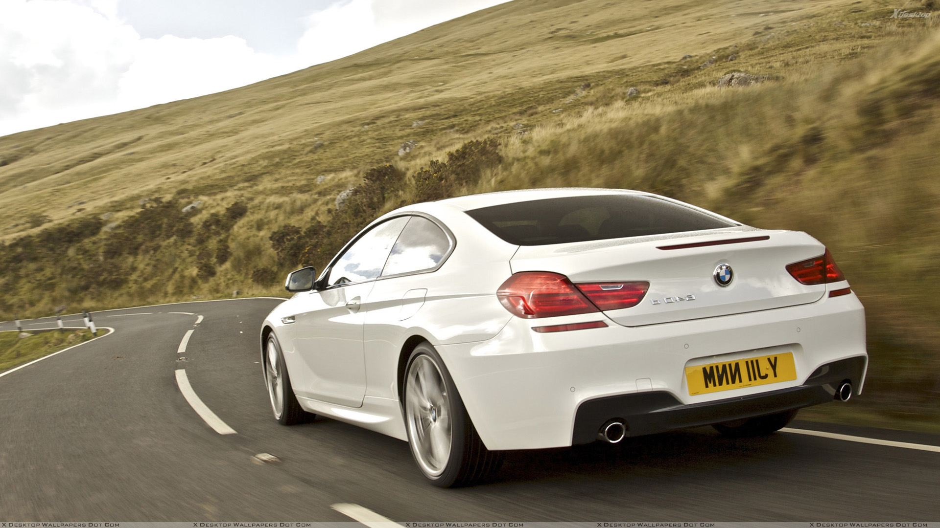 Back Pose Of 2012 BMW 6 Series Coupe in White Wallpaper