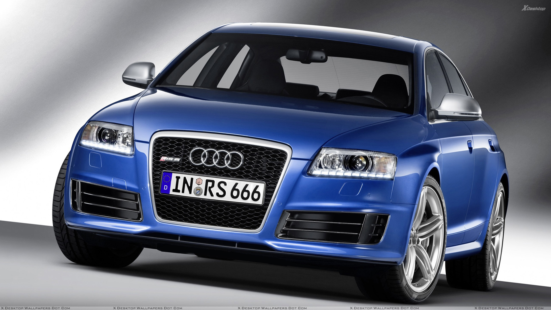 Front Pose Of 580ps Audi Rs 6 In Blue Wallpaper