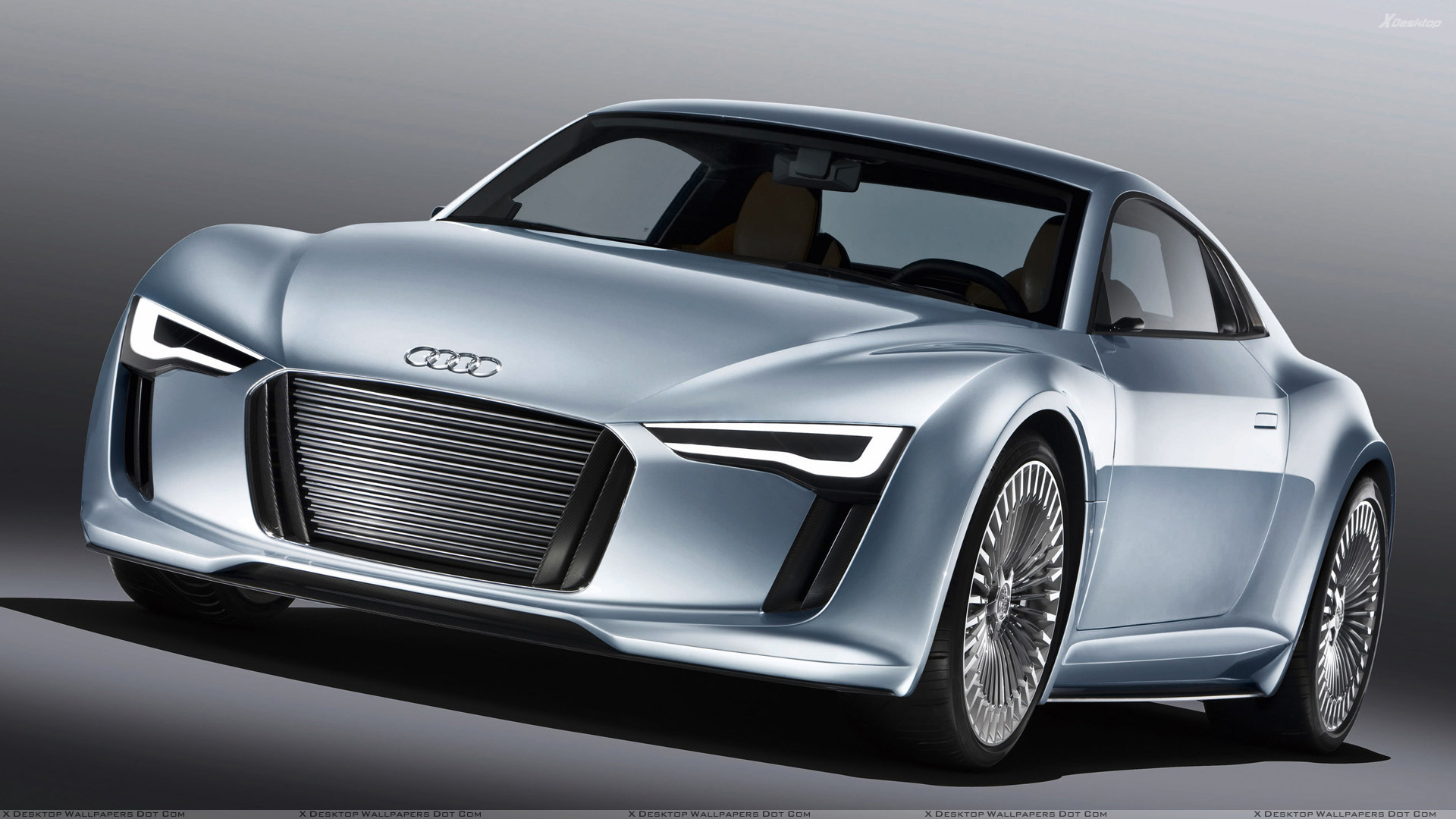 Front Side Pose Of 2010 Audi e-tron Detroit Show Car In Blue Wallpaper