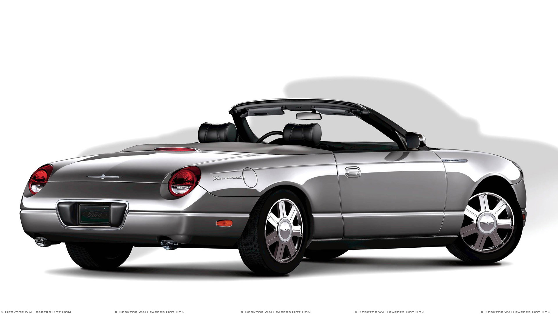 Side Back Pose Of 2005 Ford Thunderbird In Silver N White Background Wallpaper