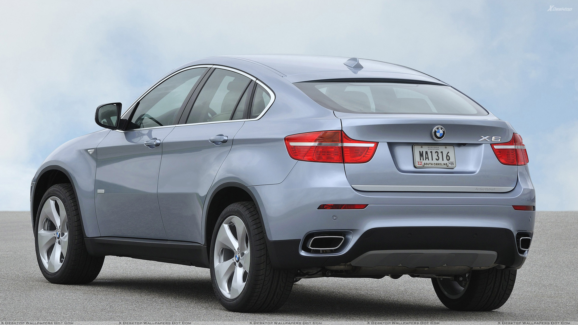 Side Back Pose Of 2010 BMW ActiveHybrid X6 In Silver Wallpaper
