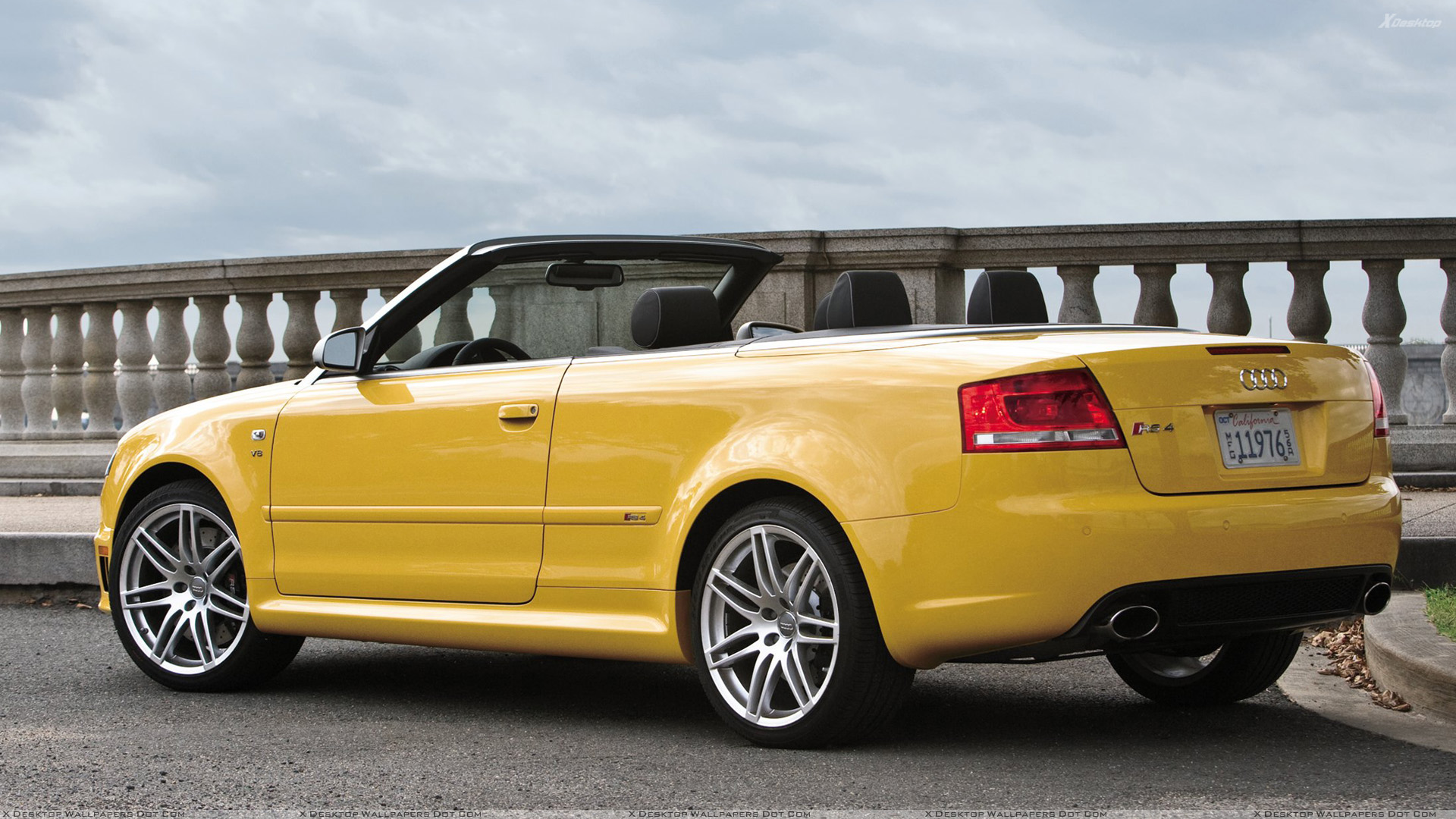 Side Back Pose Of Audi Rs4 Cabriolet In Yellow Wallpaper