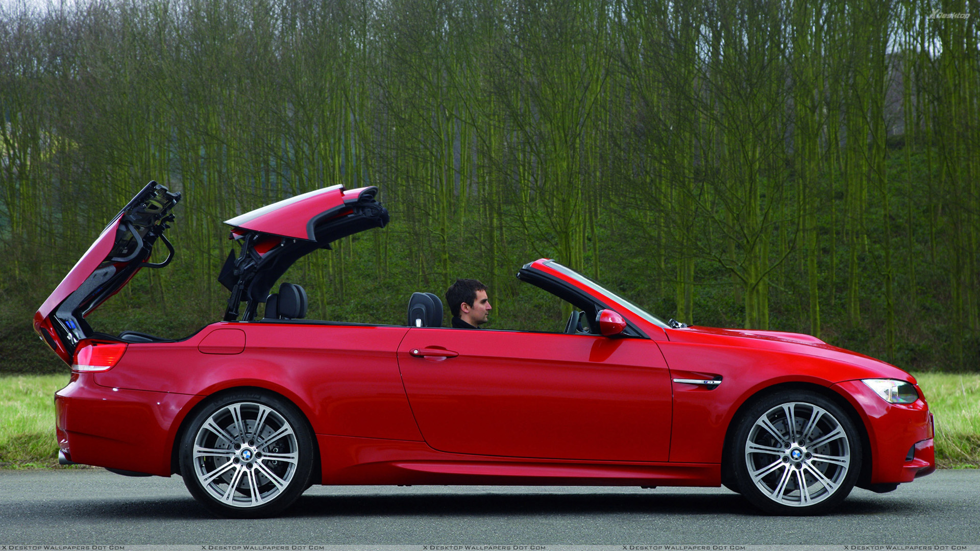 Side Pose Of 2008 Bmw M3 Convertible In Red Wallpaper