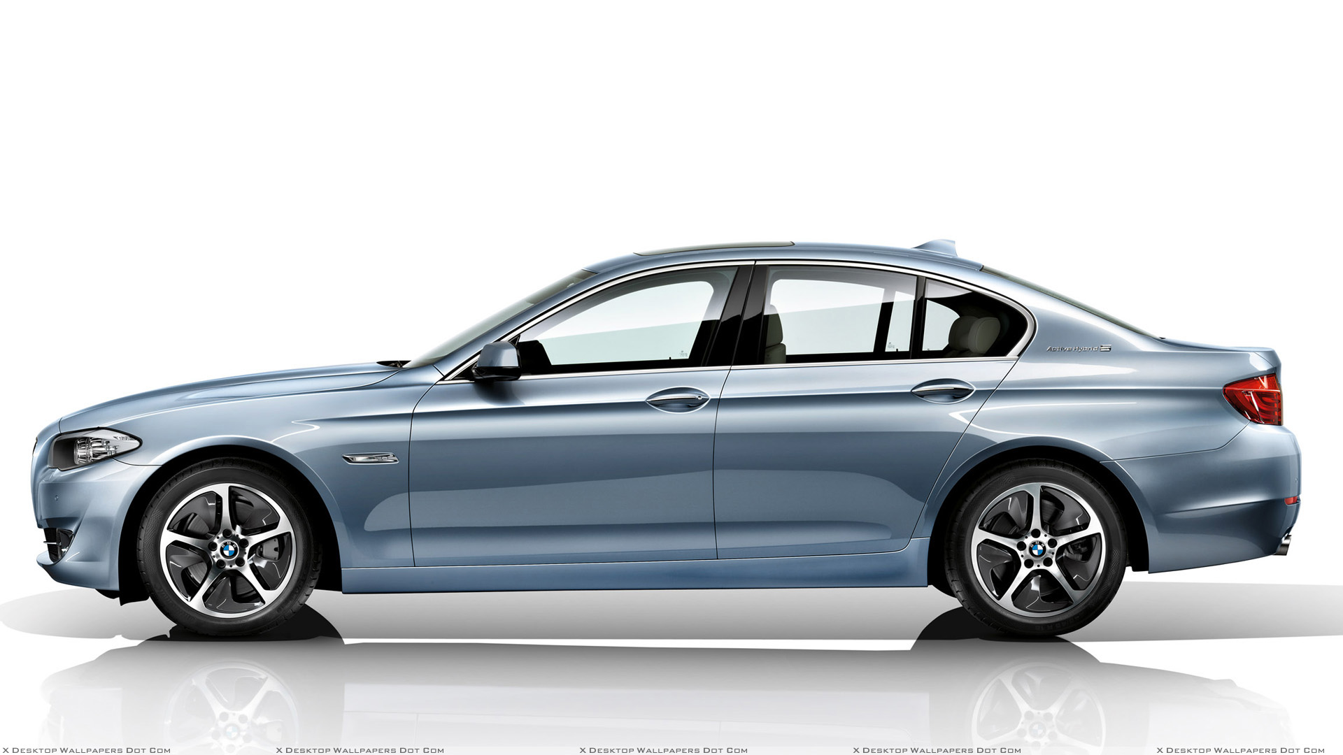 Side Pose Of Bmw Activehybrid 5 In Blue Wallpaper