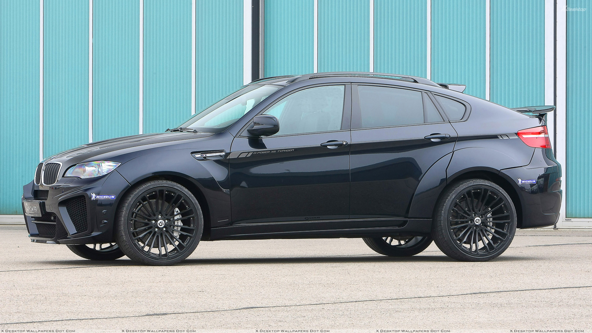 Side Pose Of G Power Bmw X6 M Typhoon Wide Body In Black Wallpaper