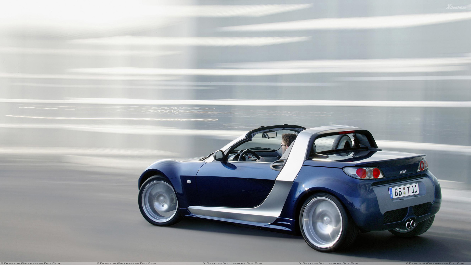smart roadster running in blue side pose wallpaper. Black Bedroom Furniture Sets. Home Design Ideas