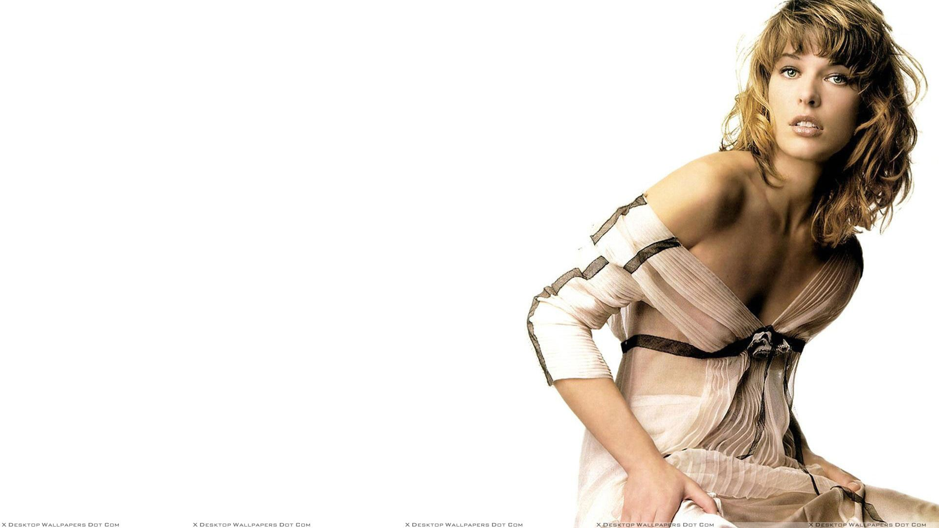 milla jovovich in transparent dress photoshoot n white background wallpaper. Black Bedroom Furniture Sets. Home Design Ideas