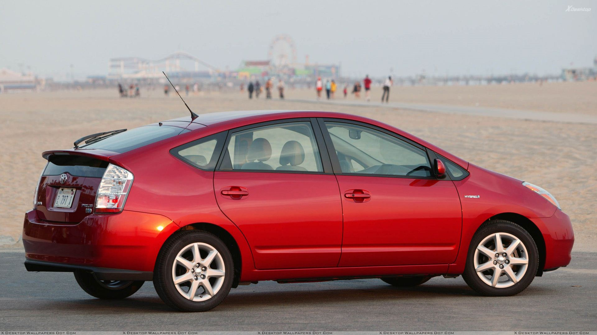 What is the difference between the prius and the prius touring.