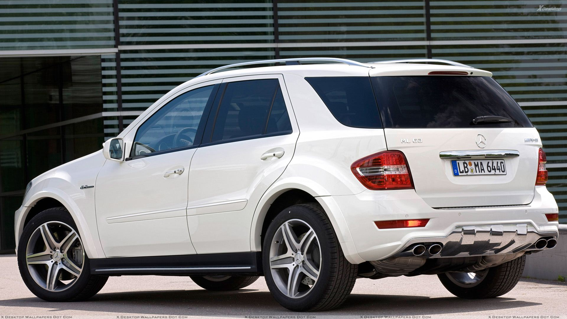 2010 Mercedes Benz ML 63 AMG Facelift Side Back Pose In White Wallpaper
