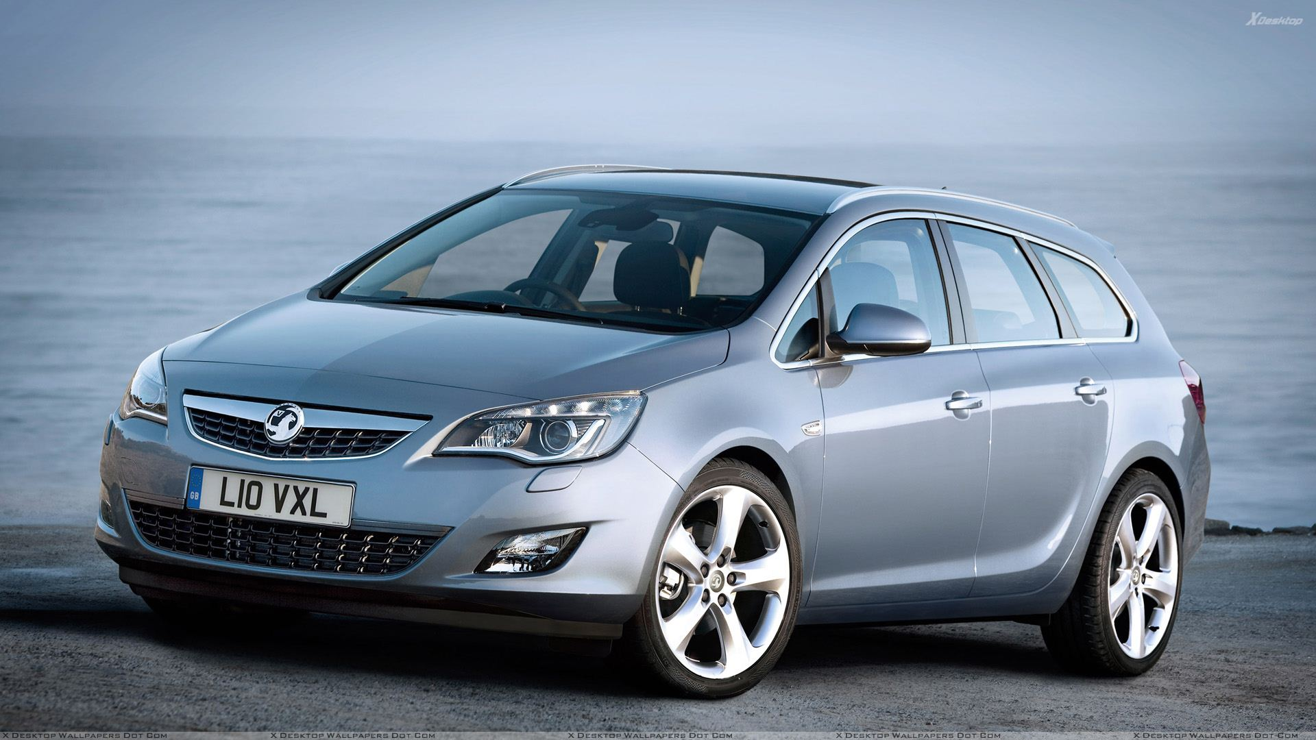 2011 vauxhall astra sports tourer front side pose near sea wallpaper. Black Bedroom Furniture Sets. Home Design Ideas