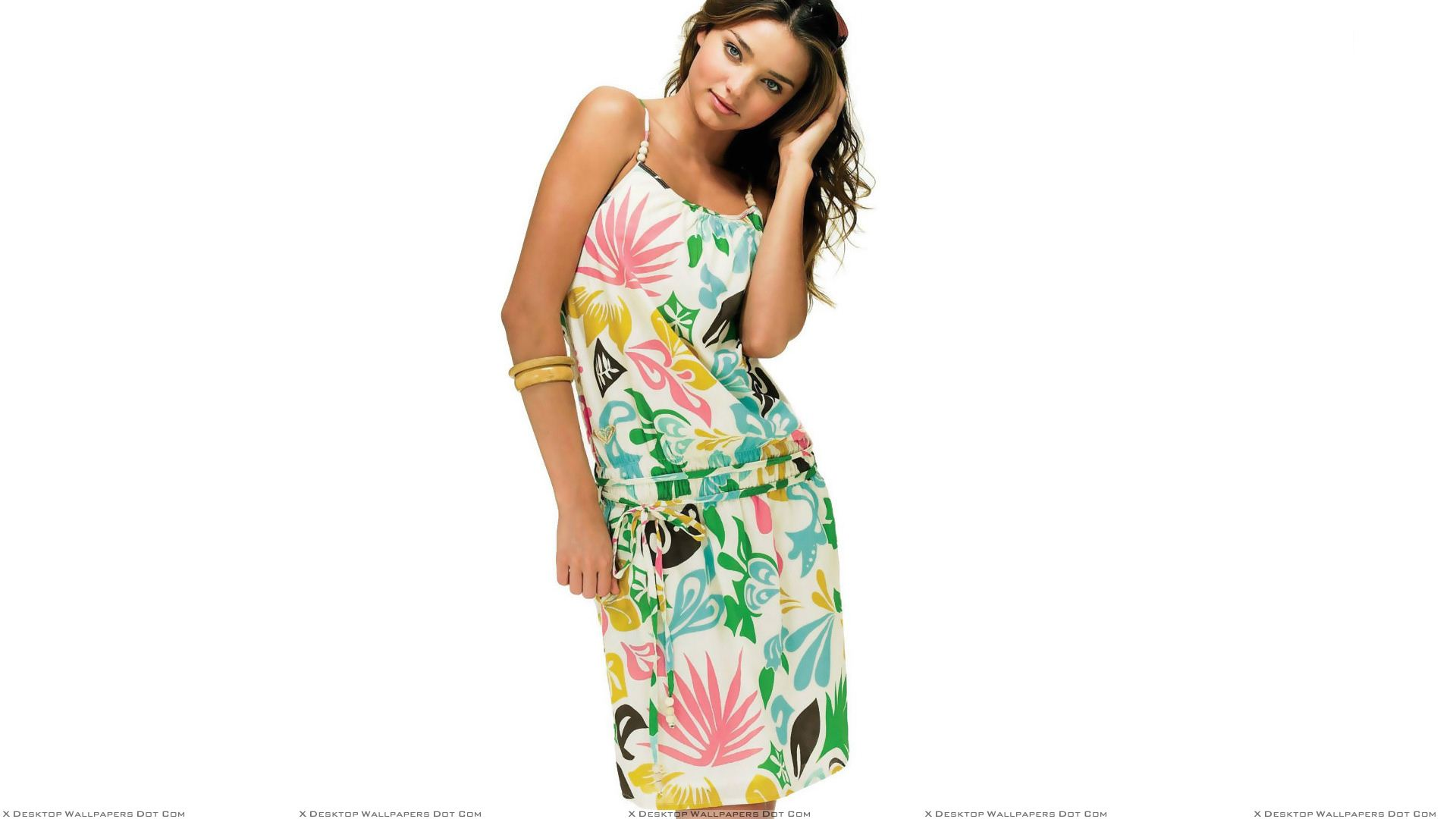 miranda kerr in colorful dress modeling pose n white background