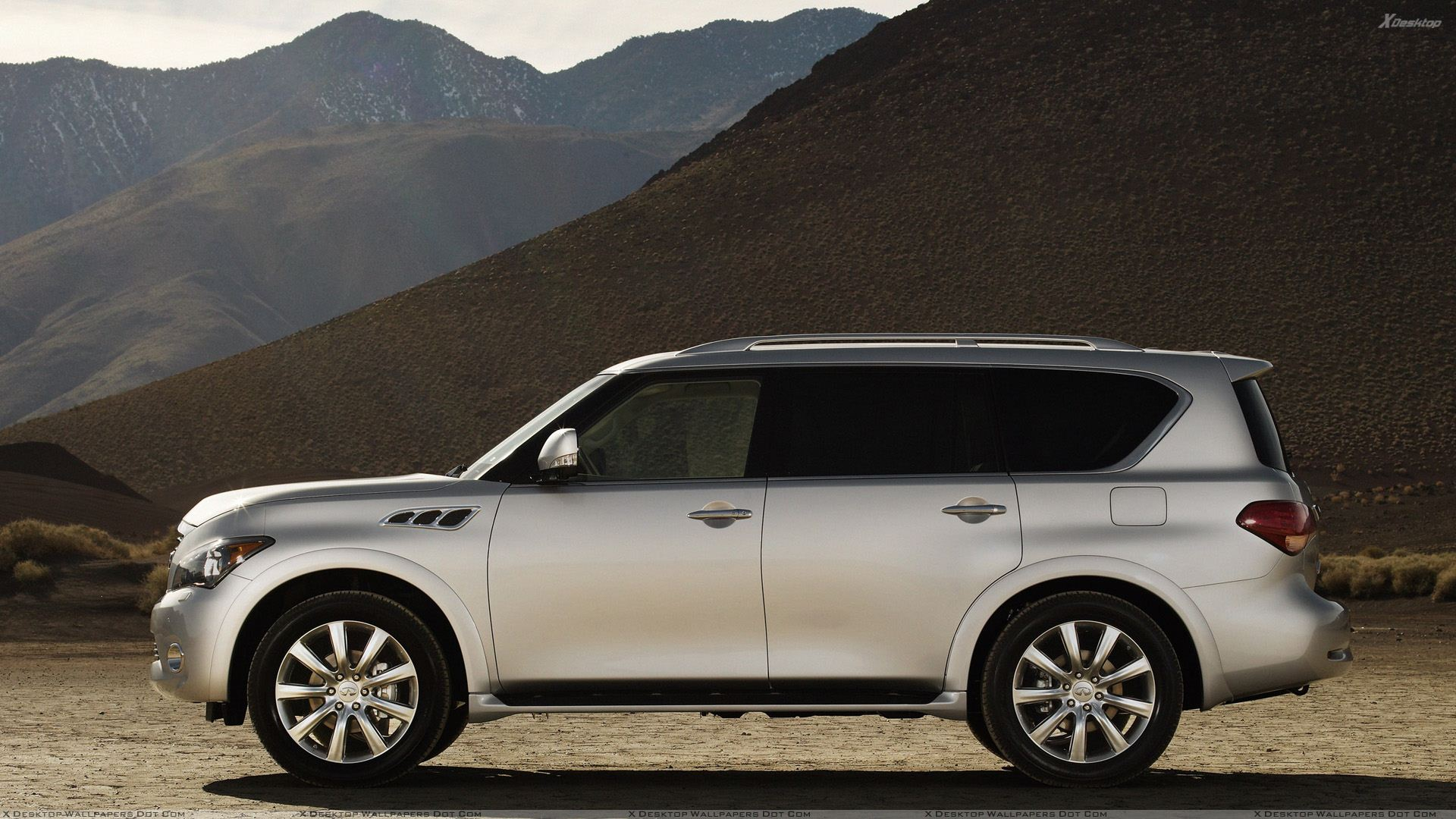 Side pose of 2011 infiniti qx56 in white near moutains wallpaper you are viewing wallpaper titled side pose of 2011 infiniti qx56 in white vanachro Image collections
