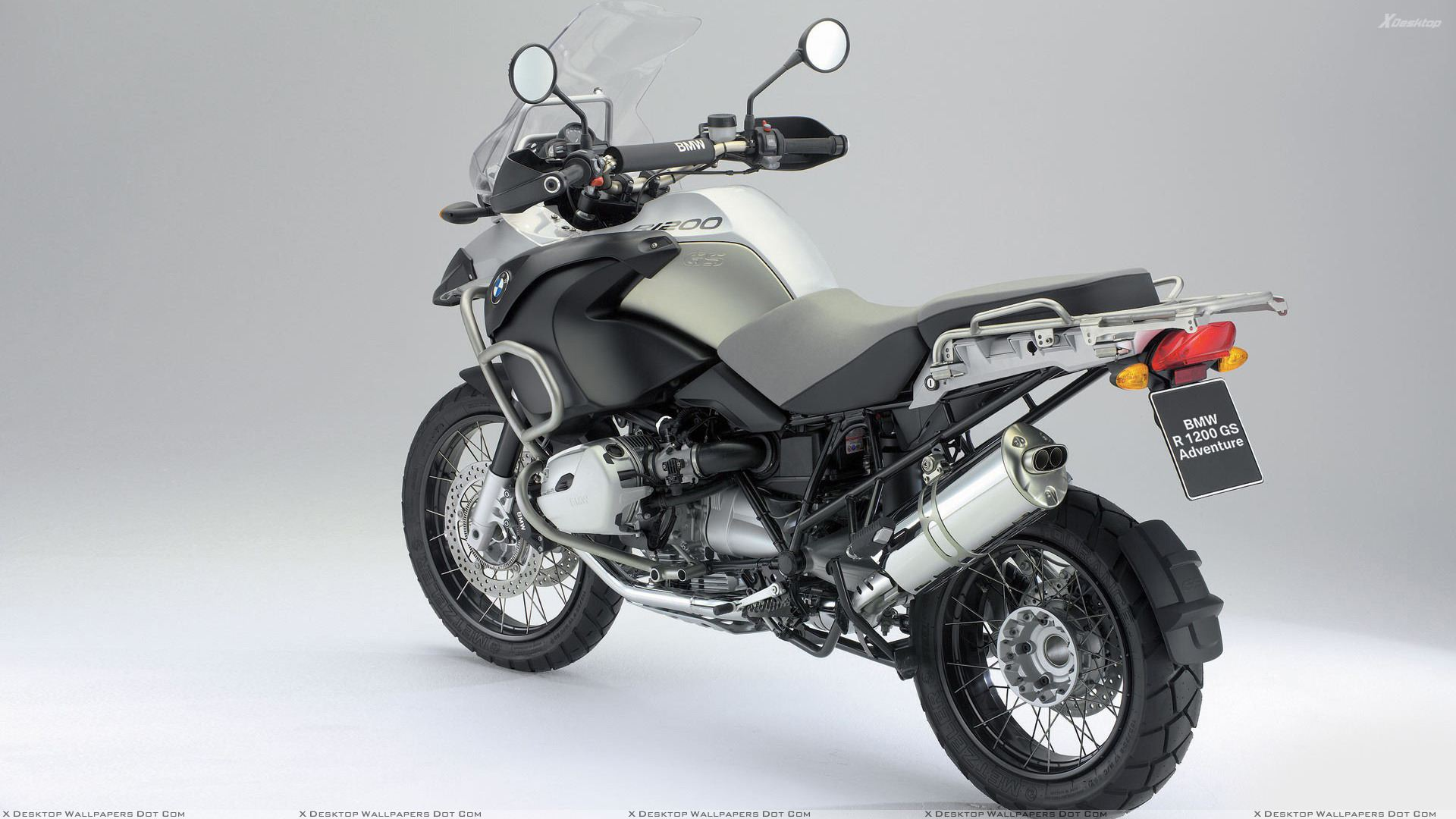 Bmw R1200 Gs In Silver Side Back Pose Wallpaper