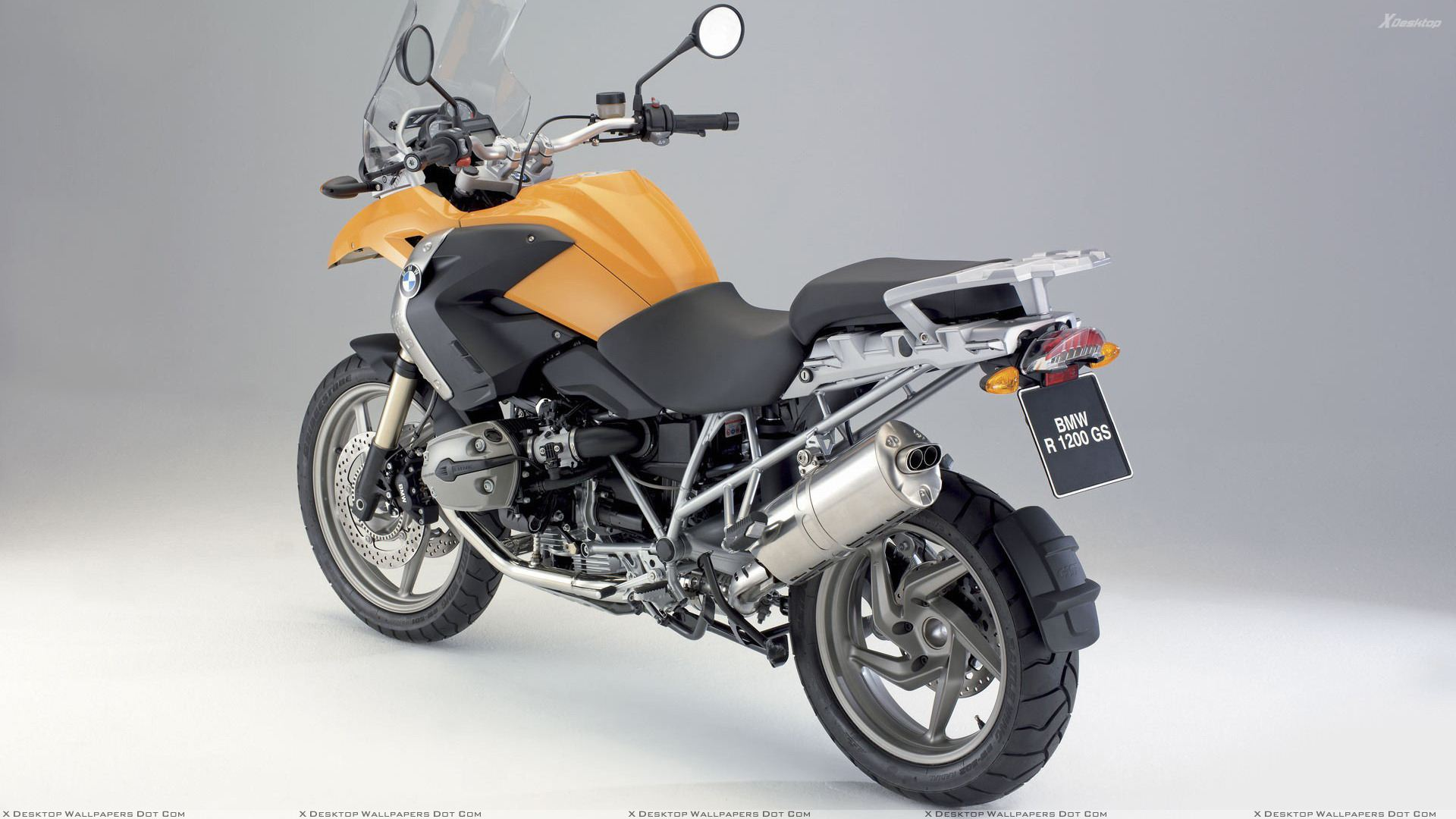 Bmw R1200 Gs In Yellow Side Back Pose Wallpaper