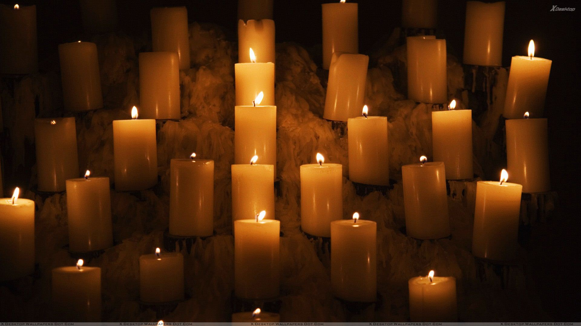 http://xdesktopwallpapers.com/wp-content/uploads/2012/07/Candle%20Lights%20In%20Church.jpg