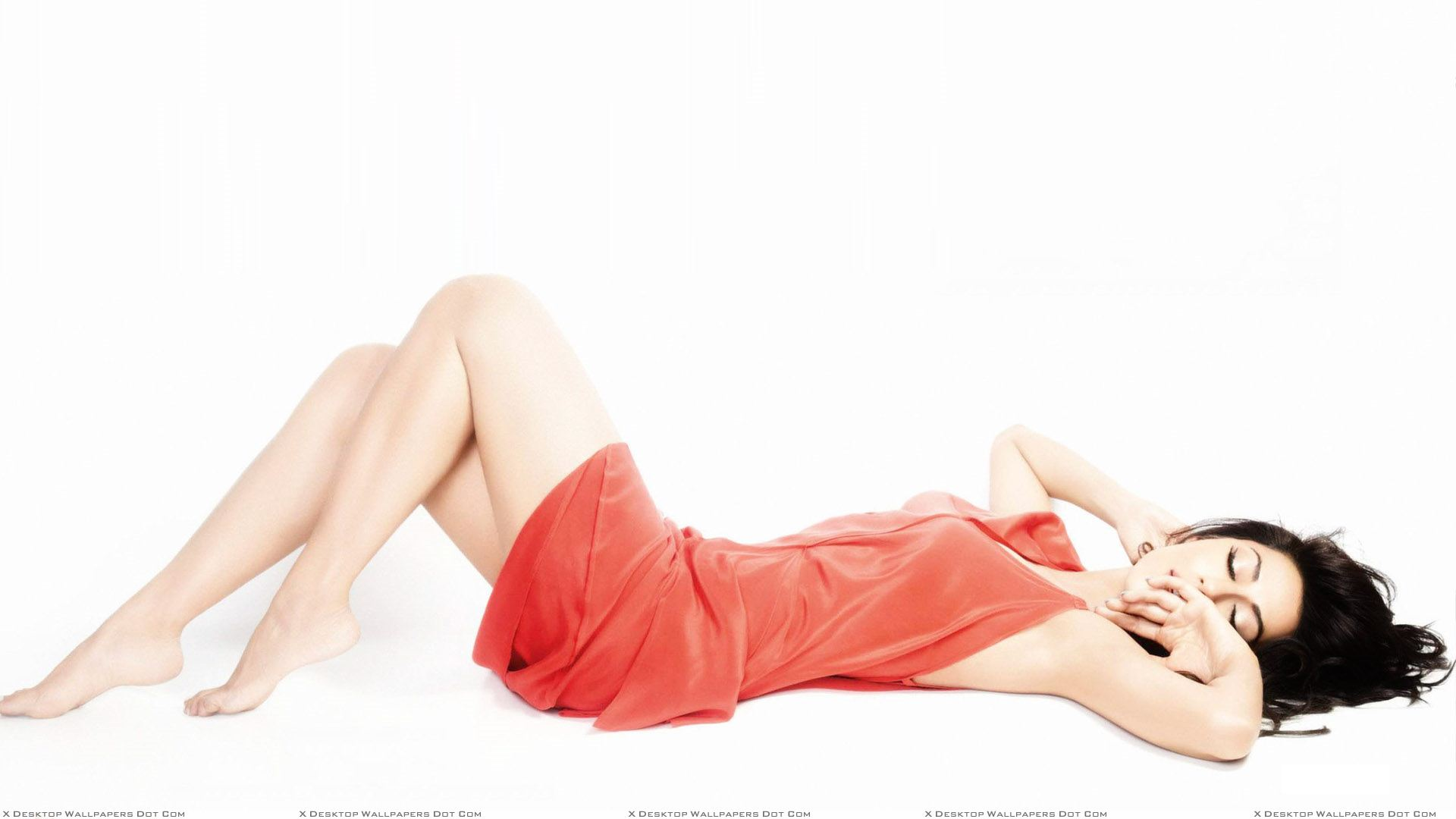 chitrangada singh sleeping n laying pose in orange dress wallpaper