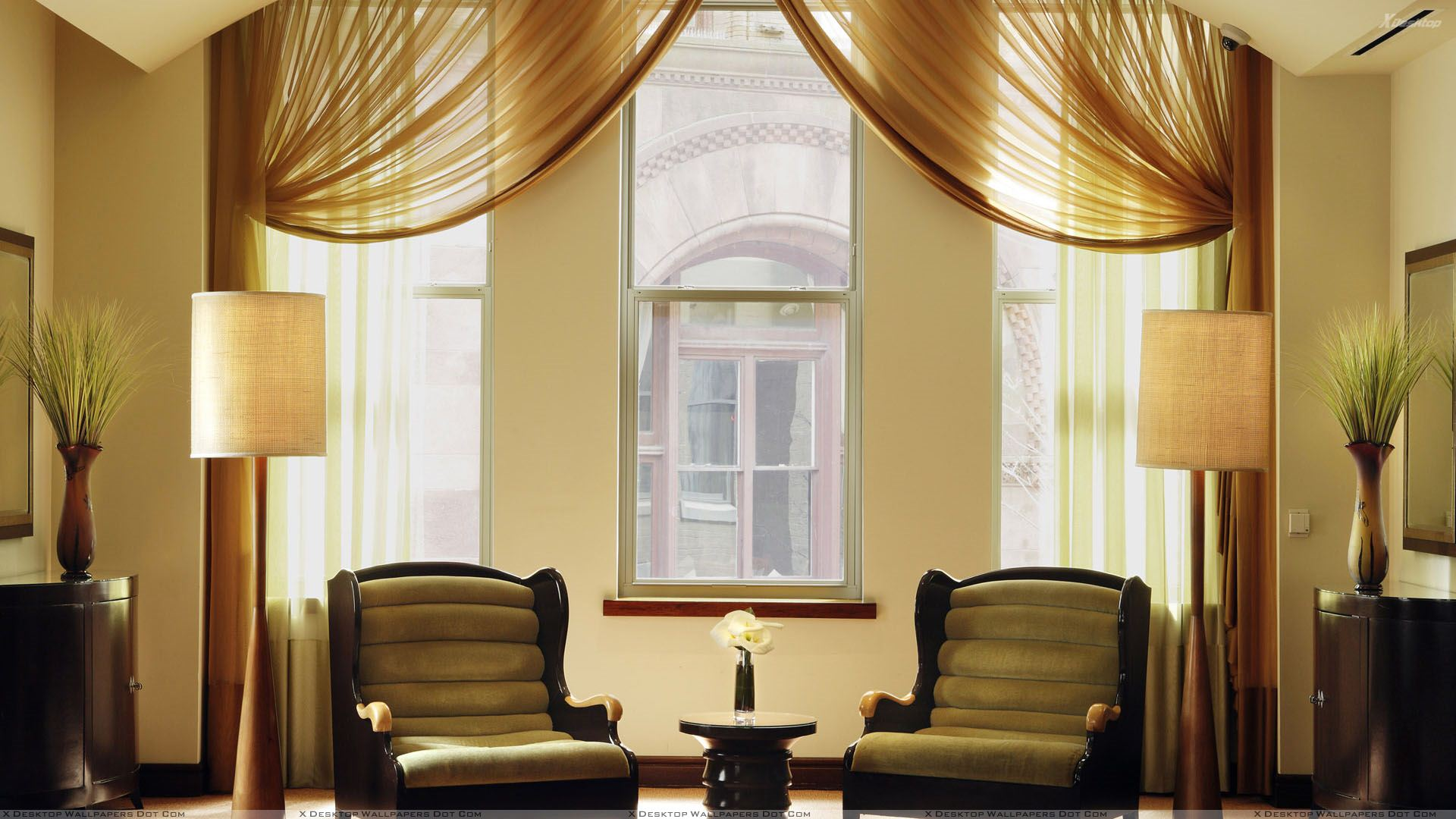 Two Brown Chairs Side Lamps in Room Wallpaper