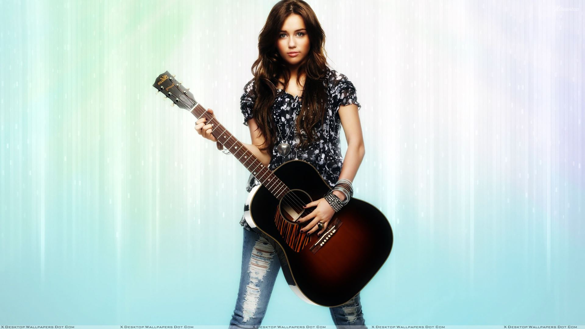 Miley Cyrus Guitar In Hand Looking Front Photoshoot Wallpaper