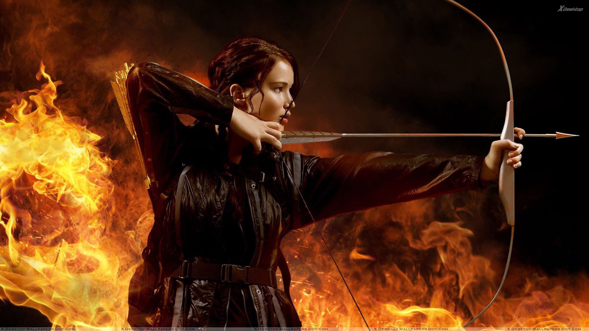 katniss everdeen with her bow aiming at something wallpaper. Black Bedroom Furniture Sets. Home Design Ideas